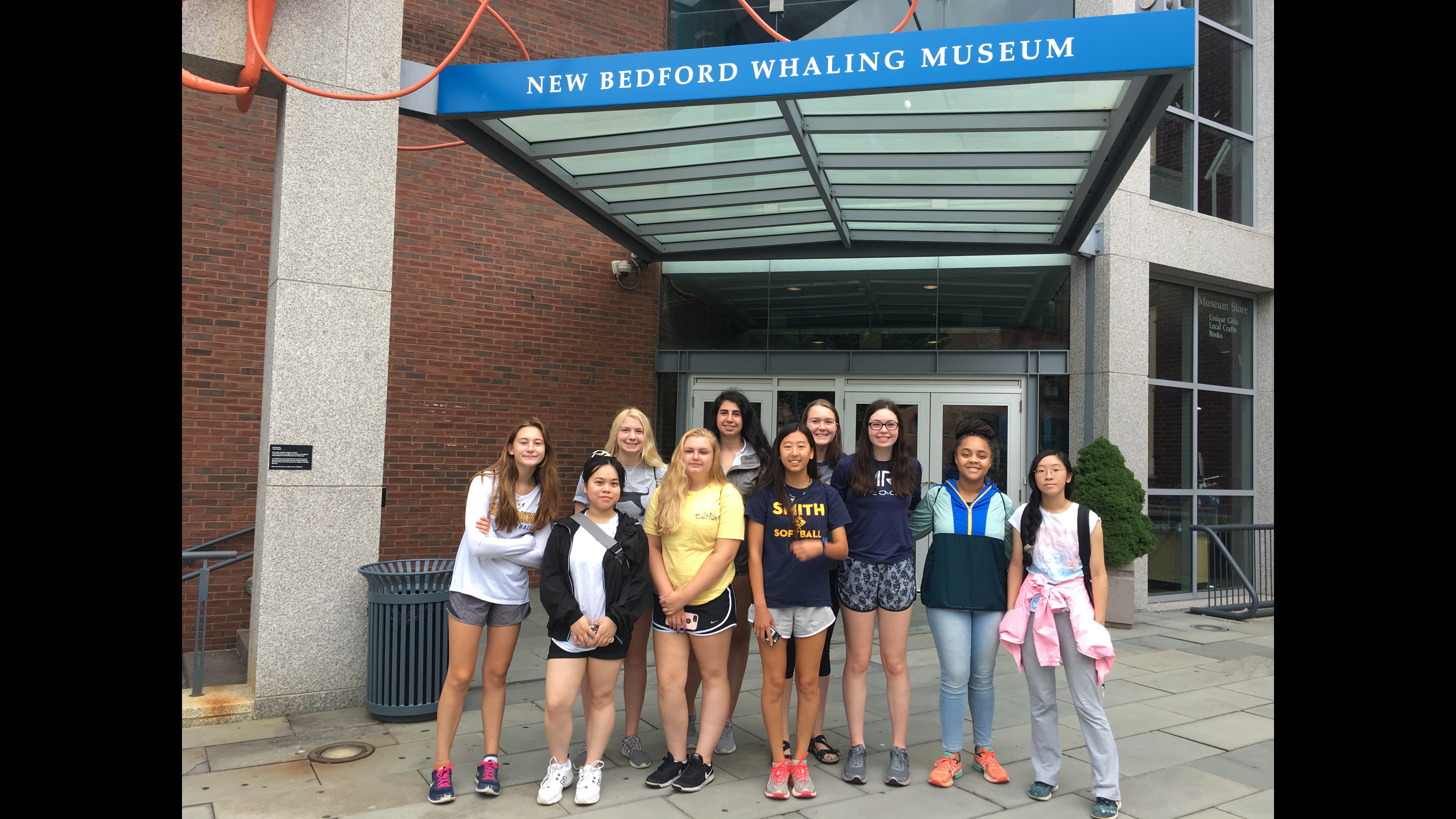 The 10 Girls in Science fellows during their field trip to the New Bedford Whaling Museum.