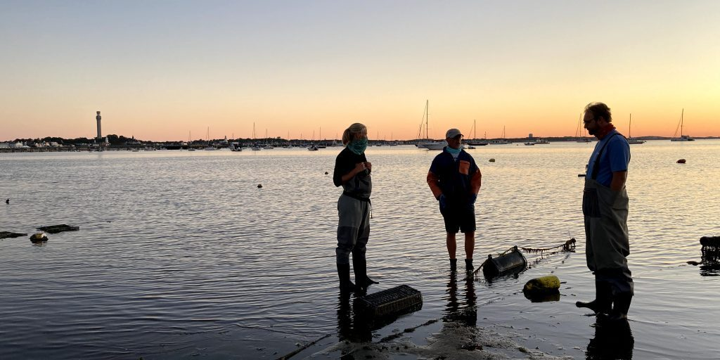 11. Next stop – Provincetown. Shellfish farmer Alex Brown discusses the plan for planting with WHSG Marine Specialist Harriet Booth and Fisheries & Aquaculture Specialist Josh Reitsma.